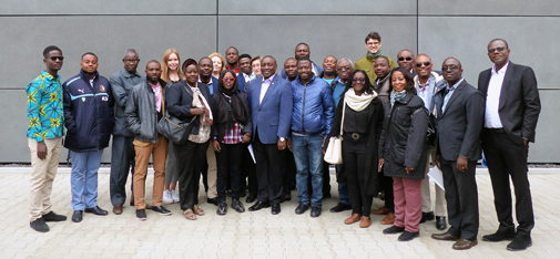 Group picture of the civil engineers, planners, contractors and construction industry representatives from Ghana after the factory tour in front of the new main building of MC-Bauchemie in Bottrop.